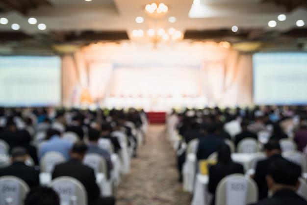 Verschwommen vom konferenzraum, von der defocuszusammenfassung und vom hintergrund der konferenzhalle