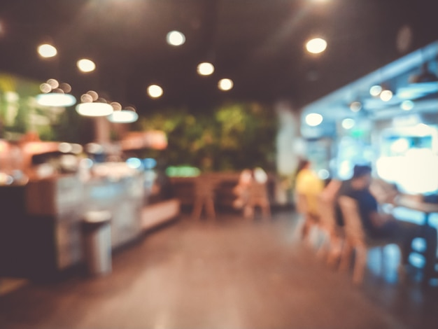Verschwommene bilder des café-café-innenhintergrunds und des beleuchtungsbokehs