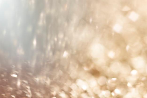 Verschwommene goldene glitzer-hintergrundtextur