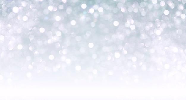 Verschwommener bokehhintergrund der weihnachten für design, winterferienglitter, farbverlauf