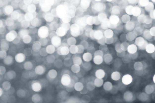 Verschwommener, glänzender, silberner glitzer mit textur
