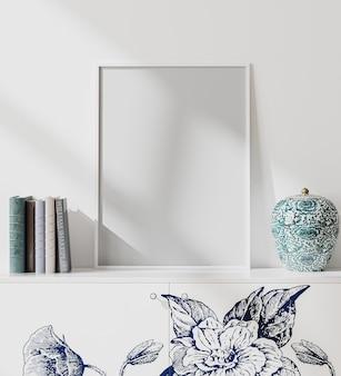 Verspotten sie den weißen leeren plakatrahmen im innenraum des modernen orientierten stils mit weißer wand, büchern und porzellanvase, japanischem stil, 3d-darstellung