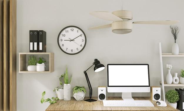 Verspotten sie herauf computer mit leerem bildschirm und dekoration im büroraumspott herauf hintergrund wiedergabe 3d