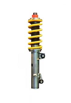 Vertikales bild eines gelben stoßdämpfers, der auf leerraum isoliert wird