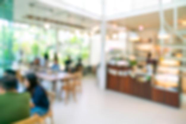 Verwischen sie kaffeestube oder caférestaurant mit abstraktem bokeh lichtbild