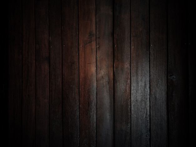 Verwitterter alter holzhintergrund der scheune mit knoten