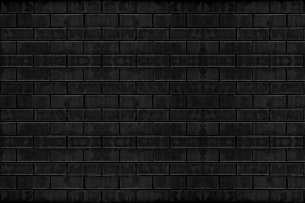 Verwitterter alter ziegelstein des dunklen schwarzen ziegelsteinwandbeschaffenheits-oberflächenhintergrund.