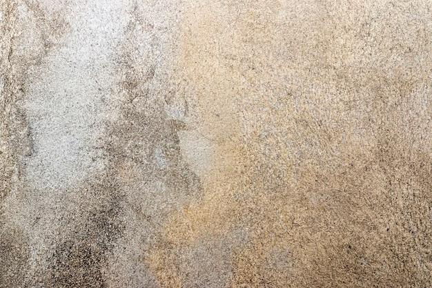 Verwitterter betonhintergrund in warmen tönen