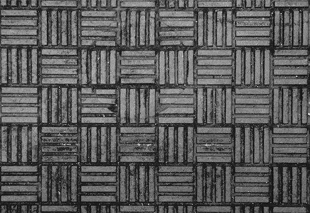 Verwitterter stahl-mannloch-texturhintergrund in monotone