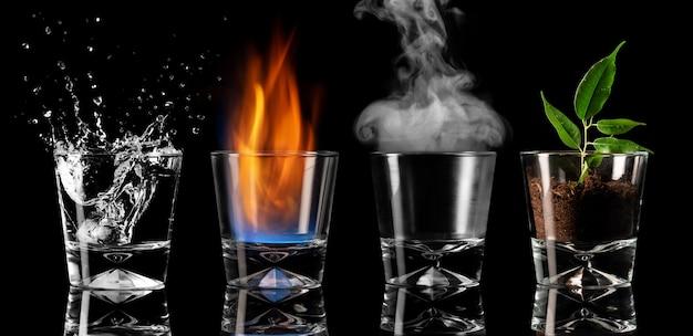 Vier symbole der elemente in gläsern, erde, wasser, luft, feuer