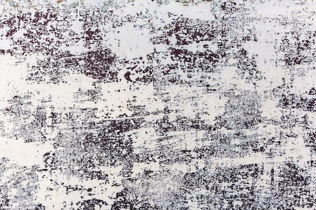 Vintage hintergrund aus blech mit abblätternder weißer farbe.