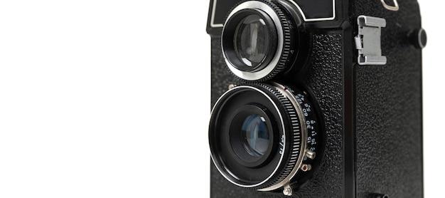 Vintage-kamera auf weißem hintergrund mit zwei linsen