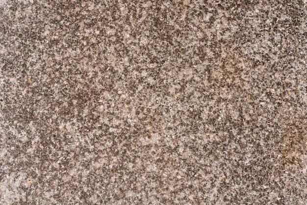 Vintage oder schmuddeliger hintergrund der natürlichen beschaffenheit des natürlichen zements oder des steins als retro-musterwand.