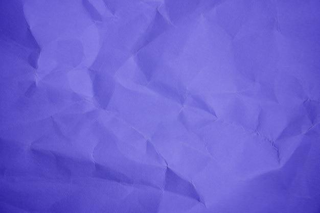 Violet sheet zerknitterte papierfarbe hintergrund nahaufnahme kopierraum