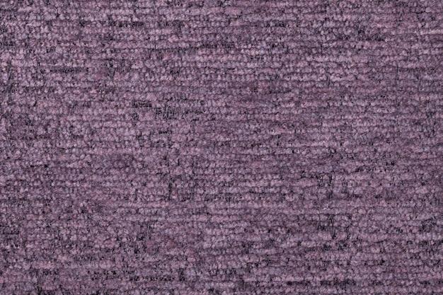 Violetter flaumiger hintergrund des weichen, flaumigen stoffes. beschaffenheit der textilnahaufnahme