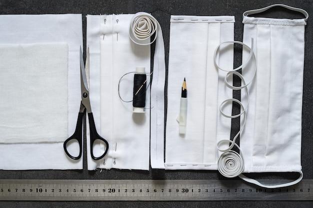Virenschutz. schutzmasken mit eigenen händen aus schwarzem stoff nähen