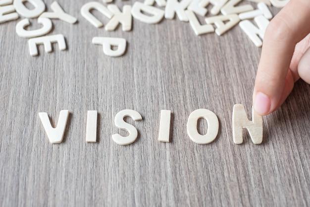Vision-wort von buchstaben des hölzernen alphabetes. geschäfts- und ideenkonzept