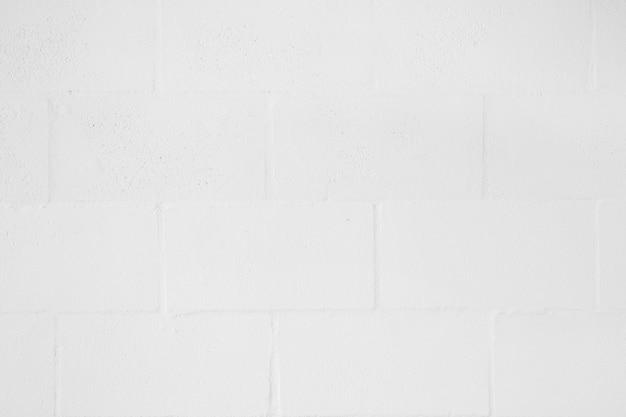 Voller rahmen der weißen leeren backsteinmauer