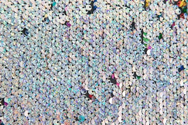 Voller rahmen von silbernen glänzenden pailletten im hintergrund