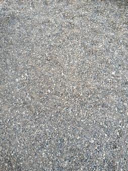 Von oben betrachten. hintergrund natürlicher grauer granitschotter, makadam. makrofoto der textur von gebrochenem stein oder schutt mit platz für text