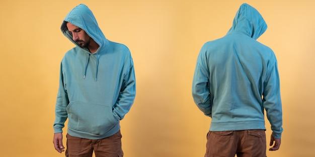 Vorder- und rückansicht eines blauen hoodie-modells für designdruck auf gelbem hintergrund