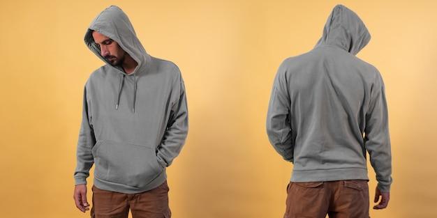 Vorder- und rückansicht eines grauen hoodie-modells für designdruck auf gelbem hintergrund