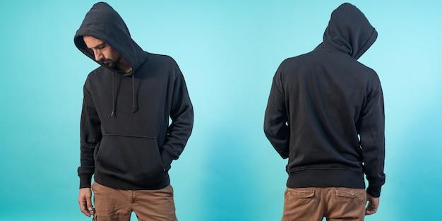Vorder- und rückansicht eines schwarzen hoodie-modells für designdruck auf blauem hintergrund