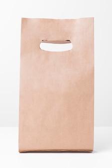 Vorderansicht der braunen papiertüte des einkaufs
