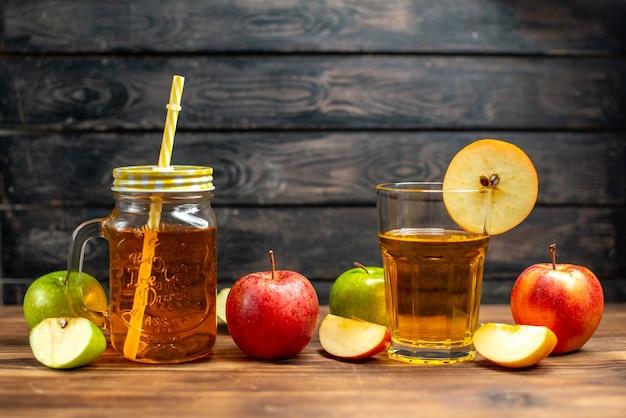 Vorderansicht frischer apfelsaft in der dose mit frischen äpfeln auf dunklem cocktailgetränk fotofrucht