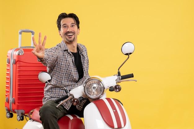 Vorderansicht junger mann auf fahrrad mit tasche auf gelb