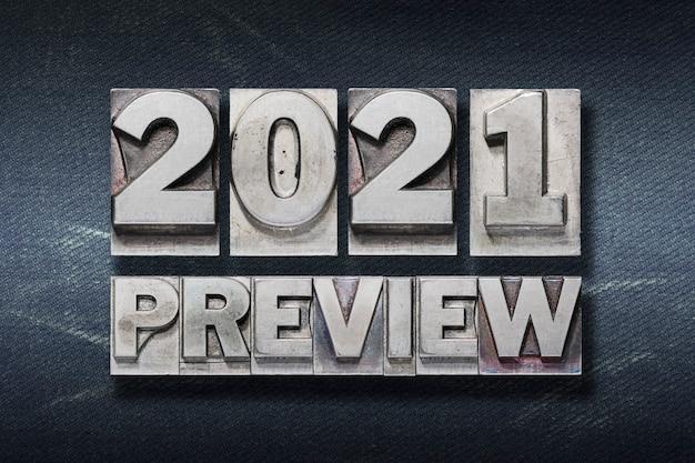 Vorschau 2021 satz aus metallischem buchdruck auf dunklem hintergrund