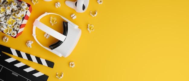 Vr-headset-controller filmklappe popcorn großer kopienraum auf kreativem gelbem hintergrund