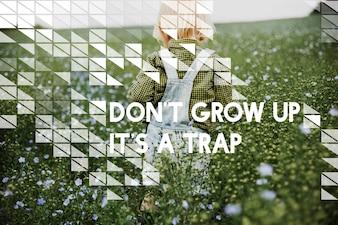 Wachsen Sie nicht auf Es ist ein Fallen-Blumen-Feld-Kind