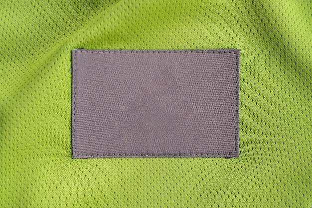 Wäschepflege-bekleidungs-label-patch auf polyester-jersey mit sporttextur