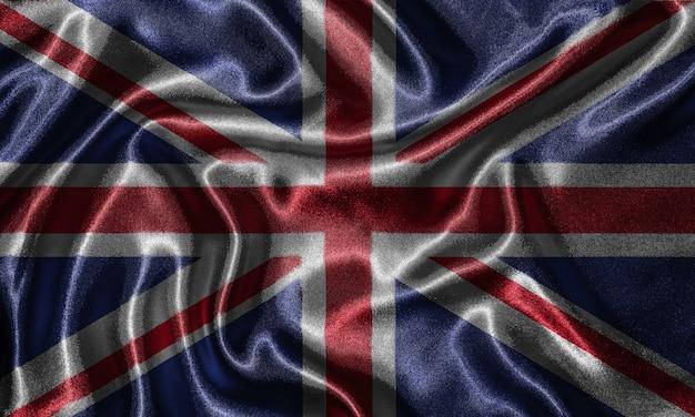 Wallpaper durch großbritannien flagge und wehende flagge von stoff.