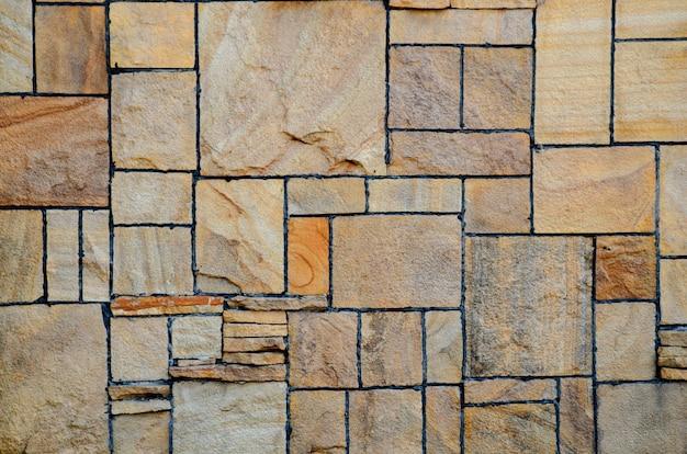 Wand aus abstrakten quadratischen steinen