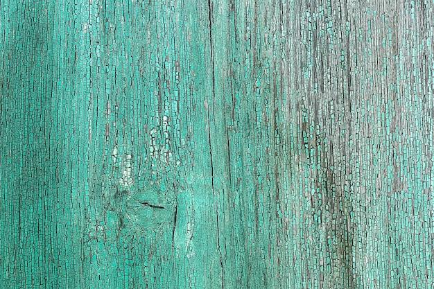Wand aus holzbohlen von blauer farbe mit rissen. hintergrund für die gestaltung.