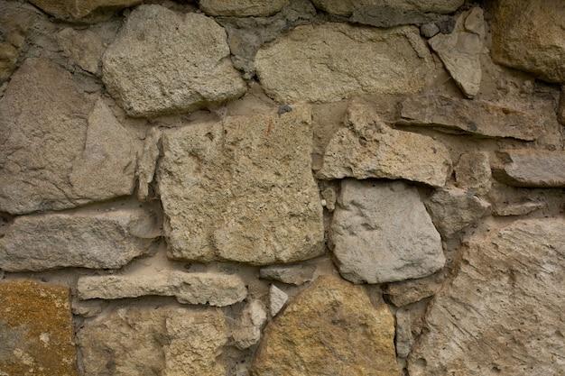 Wand aus wildem stein. nahaufnahme
