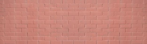 Wand aus ziegeln in lachsfarbe gestrichen