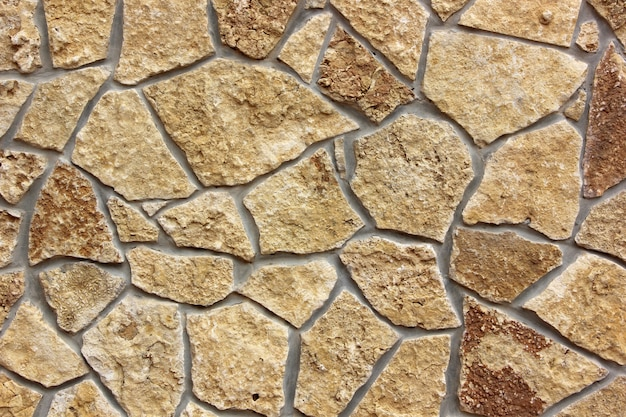 Wand fertig mit naturstein. textur, hintergrund.