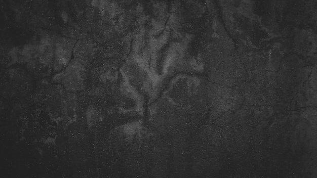 Wandbeschaffenheitszement dunkelschwarzer grauer hintergrund. steinmauer hintergrund. konkreter beschaffenheitshintergrund.