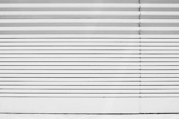 Wandhintergrund der geometrischen linien des weißen metalls