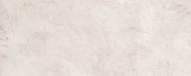 Warmweißer grober körniger steinbeschaffenheitshintergrund