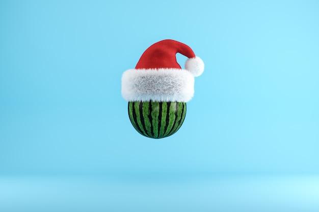 Wassermelone mit santa hat, die auf blau schwimmt