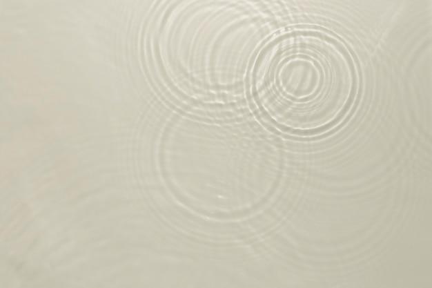 Wasserwellenbeschaffenheitshintergrund, braunes design