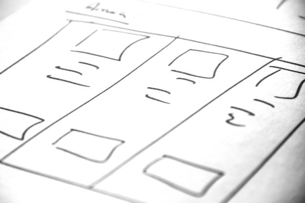 Weblayout-skizzenpapier buch, drahtmodell - mobil- und web-skizze