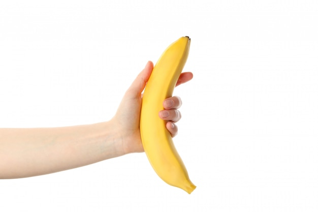 Weibliche hand hält banane, isoliert