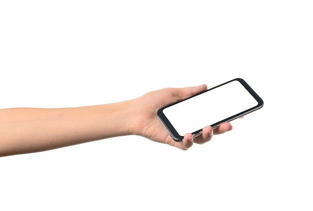 Weibliche hand mit modernem mobiltelefon auf weißem hintergrund