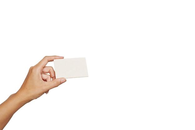 Weibliche oder männliche hand, die leere karte auf weiß hält