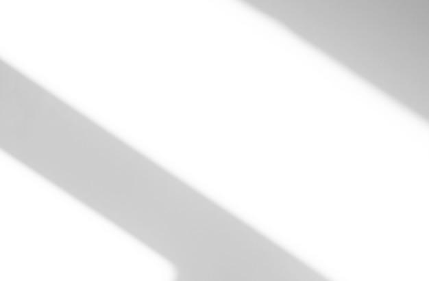 Weiche abstrakte schatten und silhouetten von linien an der wand als textur oder hintergrund